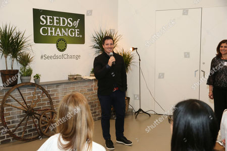 Stock Photo of Chef Seamus Mullen shares the impact of the annual Seeds of Change Grant Program, helping people create healthier and greener communities, at Project Farmhouse in New York on