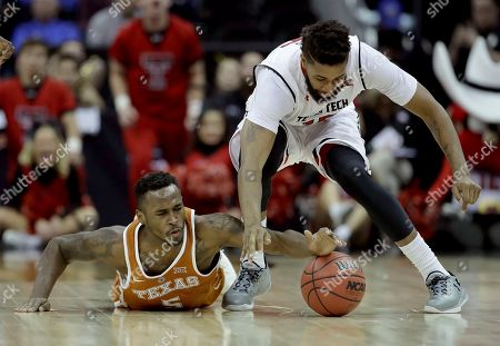 Stock Picture of Texas' Kendal Yancy (5) and Texas Tech's Aaron Ross (15) chase a loose ball during the second half of an NCAA college basketball game in the Big 12 tournament, in Kansas City, Mo. Texas won 61-52
