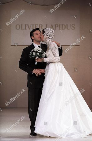 French Designer Olivier Lapidus Arrives on the Podium with the Model During the Fashion Show in Moscow Russia 26 November 1996 Russian Federation Moscow