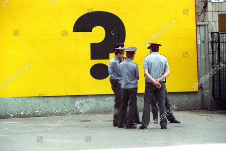 Stock Picture of A Group of Ukrainian Policemen Stand at the Question Mark Poster Kiev Ukraine 20 May 1994 Ukraine Kiev