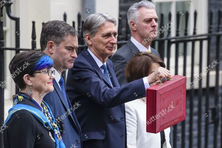 Baroness Neville-Rolfe, David Gauke MP, Chancellor of the Exchequer Philip Hammond MP, Jane Ellison MP and Simon Kirby MP leave 11 Downing Street in London before the British Chancellor delivers his 2017 Budget to Parliament.