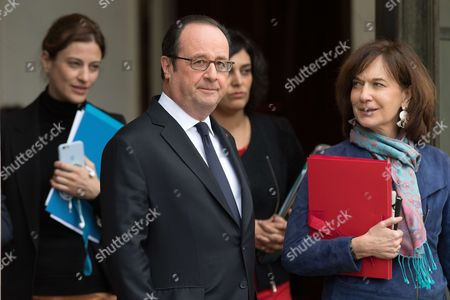 French President Francois Hollande, State Secretary in charge of Victims Juliette Meadel, Labor Minister Myriam El Khomri and Annick Girardin