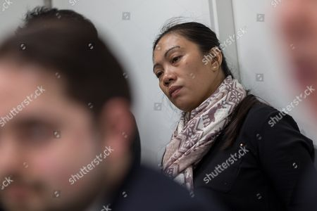 Filipino asylum seeker Vanessa Mae Bondalian Rodel listens during a press conference in Hong Kong, China, 09 March 2017. Her lawyers announced that Canada has been officially petitioned to accept into Canada the asylum seeking families who sheltered former US intelligence whistle-blower Edward Snowden in Hong Kong in 2013. The role of the refugees who sheltered Snowden for about two weeks was only reported in September 2016. Claims emerged recently that Sri Lankan police had been in the city looking for some of them.