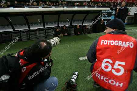 Photographers Shoot Towards the Players Bench where Coach and Assistant Carlo Ancelotti and Mauro Tassotti (l) Sit with Player Gennaro Gattuso Italy Milan