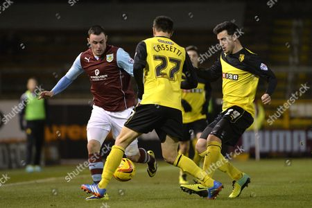 Stock Image of Keith Treacy of Burnley is Tracked by Marco Cassetti and George Thorne of Watford Gb Burnley