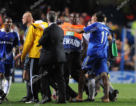 Chelsea Players Including Didier Drogba John Terry and Florent Malouda Confront Referee Tom Henning Ovrebo at Full Time United Kingdom London