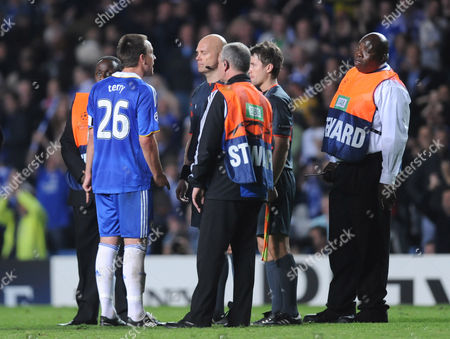 John Terry of Chelsea Confronts Referee Tom Henning Ovrebo at Full Time United Kingdom London