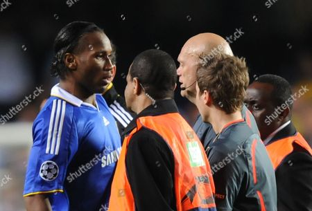 Didier Drogba of Chelsea Having Already Been Substituted Confronts Referee Tom Henning Ovrebo at Full Time United Kingdom London