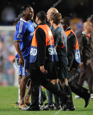 Didier Drogba of Chelsea Having Already Been Substituted Confronts Referee Tom Henning Ovrebo at Full Time Wearing His Flip Flops United Kingdom London