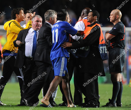 Stewards and Chelsea Staff Try and Restrain Didier Drogba From Confronting Referee Tom Henning Ovrebo at Full Time United Kingdom London