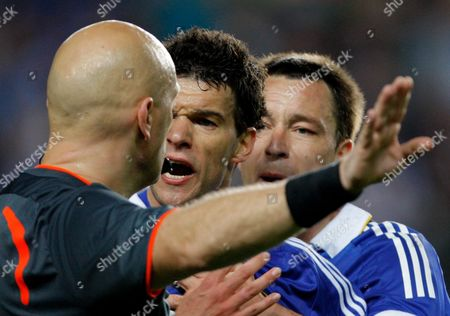Michael Ballack and John Terry of Chelsea Confront Referee Tom Henning Ovrebo After He Refused Their Side A Penalty United Kingdom London