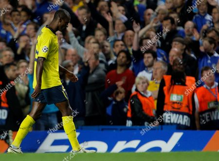 A Dejected Eric Abidal of Barcelona Walks Off After Being Sent Off by Referee Tom Henning Ovrebo For A Foul On Nicolas Anelka of Chelsea United Kingdom London