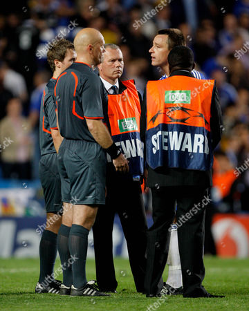 John Terry of Chelsea Confronts Referee Tom Henning Ovrebo About His Decisions Throughout the Course of the Game United Kingdom London