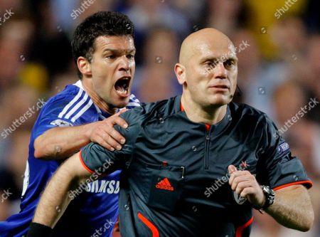 Referee Tom Henning Ovrebo Runs Away From A Screaming Michael Ballack of Chelsea United Kingdom London