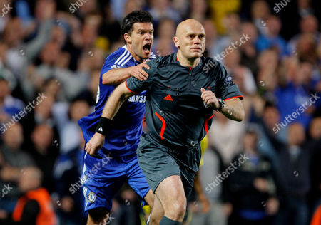 Michael Ballack of Chelsea Grabs Referee Tom Henning Ovrebo Claiming For A Handball by Samuel Eto'o of Barcelona in Injury Time United Kingdom London