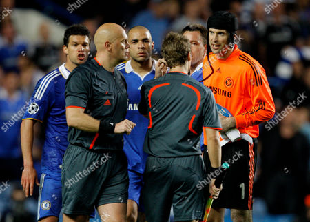 Chelsea Players Confront Referee Tom Henning Ovrebo About His Decisions Throughout the Game United Kingdom London