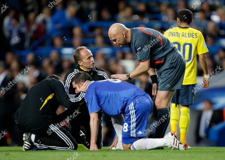 Stock Picture of Referee Tom Henning Ovrebo Checks On Frank Lampard of Chelsea As He Receives Medical Treatment United Kingdom London