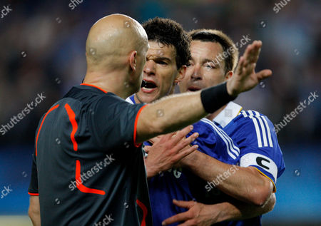 John Terry Holds Back Michael Ballack of Chelsea While He Angrily Confronts Referee Tom Henning Ovrebo About A Missed Handball Penalty United Kingdom London
