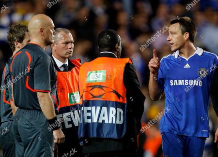 John Terry of Chelsea Confronts Referee Tom Henning Ovrebo at the Final Whistle United Kingdom London