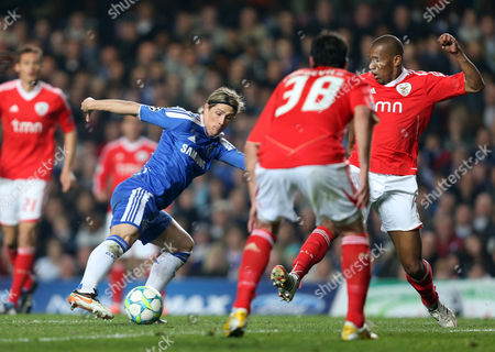 Fernando Torres of Chelsea in Action with Joan Capdevila and Emerson of Benfica United Kingdom London