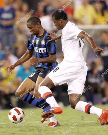 Stock Photo of Samuel Eto'o of Inter Milan Moves Past Dedryk Boyata of Manchester City United States Baltimore