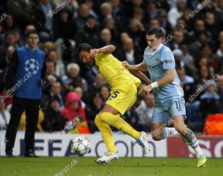 Adam Johnson of Manchester City and Carlos Marchena of Villarreal United Kingdom Manchester