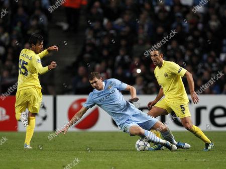 Edin Dzeko of Manchester City and Carlos Marchena of Villarreal United Kingdom Manchester