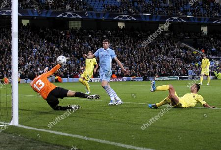 Carlos Marchena of Villarreal Scores an Own Goal Under Pressure From Edin Dzeko of Manchester City to Make It 1-1 United Kingdom Manchester