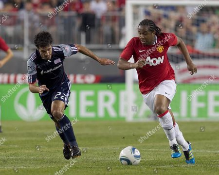 Stock Picture of Manchester United's Anderson (r) is Closed Down by New England Revolution's Benny Feilhaber (l) United States Foxborough, Ma