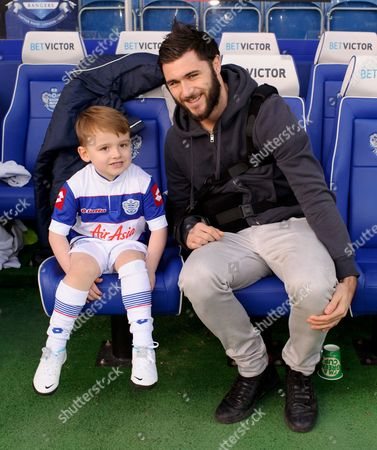 Charlie Austin of Qpr Talks with Ollie Who is the Grandson of Tony Mills - Qpr Fan Mills Was Recently Diagnosed with Terminal Brain Cancer and Was Presented with Vip Tickets to What May Be His Last Ever Match by Joey Barton Who Personally Delivered the Tic Gb London