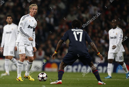 Jose Maria Gutierrez of Real Madrid Prepares to Kick in Front of Jean Ii Makoun of Olympique Lyonnais Spain Madrid