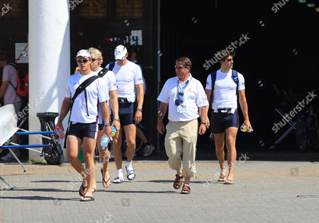 Great Britain head rowing coach Jurgen Grobler walks with the men's four (L to R) Steve Williams, Andy Hodge, Peter Reed and Tom James