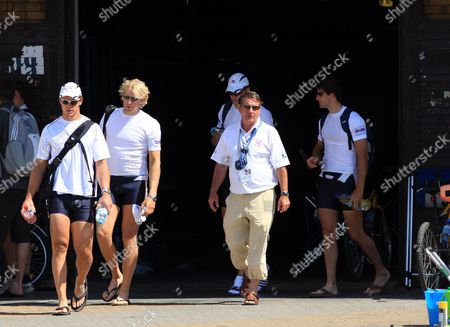 Great Britain head coach Jurgen Grobler leaves the boathouse with the men's four (L to R) Steve Willliams, Andy Hodge, Peter Reed and Tom James