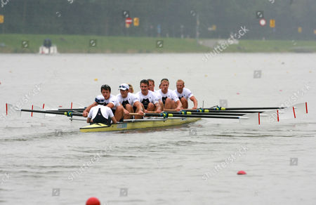 Steve Williams of Great Britain strokes the Men's Eight containing Andrew Hodge, Peter Reed and Alex Partridge