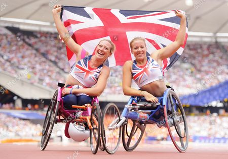 Melissa Nicholls and Hannah Cockroft of Great Britain Pose with the Union Jack Flag After the 100m Women T33/34 Final United Kingdom London