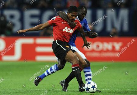 Antonio Valencia of Manchester United Grapples with Hans Sarpei of Fc Schalke 04 Germany Gelsenkirchen