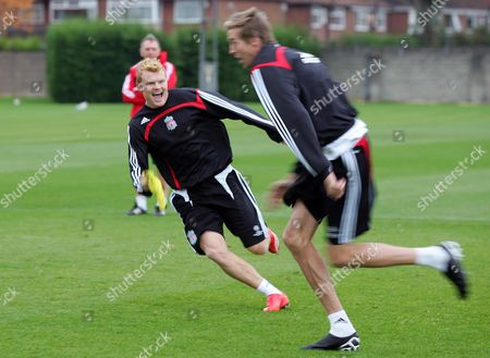 Stock Picture of John Arne Riise chases Peter Crouch during training