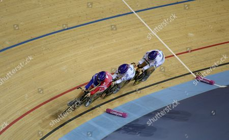 Laura Trott Wendy Houvenaghel and Joanna Rowsell of Team Gb On Route to Winning the Womens Team Pursuit and Setting A New World Record United Kingdom London