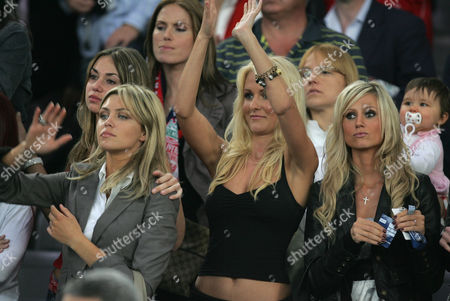 Chloe Patjzer, girlfriend of Bolo Zenden, Abbey Clancy, girlfriend of Peter Crouch of Liverpool, Amii Grove (clapping), girlfriend of Jermaine Pennant and Maria,(r)  girlfriend of John Arne Riise