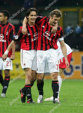 Filppo Inzaghi and Andriy Schevchenko (R) celebrate the victory for AC Milan.