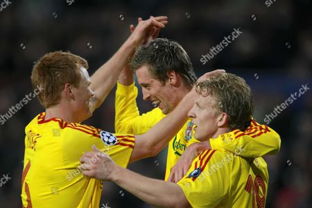 Peter Crouch of Liverpool celebrates scoring the third goal with team mates John Arne Riise and Dirk Kuyt