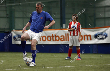 Former Manchester United player Gary Pallister coaches the Ford Centre Circle mascots