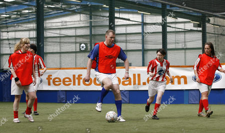 Former Manchester United player Gary Pallister plays a match with the Ford Centre Circle mascots