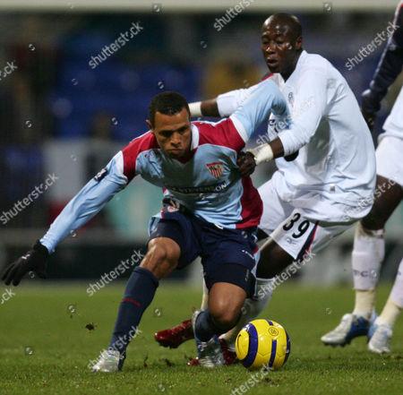 Luis Fabiano of Sevilla and Khalilou Fadiga of Bolton Wanderers
