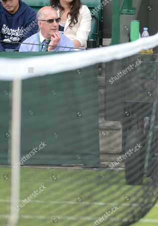 Stock Image of Line Judge Andrew Mcdougall Who Was Recently Injured by David Nalbandian at Queen's Club Looks On As A Reserve Official On One of the Outside Courts United Kingdom London