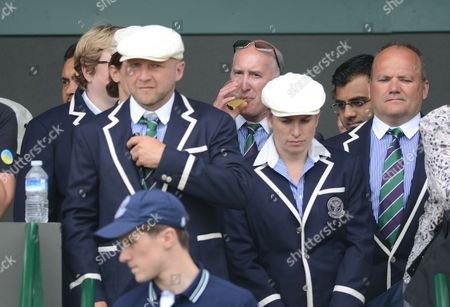 Stock Photo of Line Judge Andrew Mcdougall Who Was Recently Injured by David Nalbandian at Queen's Club Has A Drink (centre) Before Going Onto Court United Kingdom London