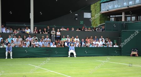 Line Judge Andrew Mcdougall Who Was Recently Injured by David Nalbandian at Queen's Club in Action On an Outside Court (far Left) with A Towel On the Far Right Hand Side Spelling the Word 'Bled' United Kingdom London