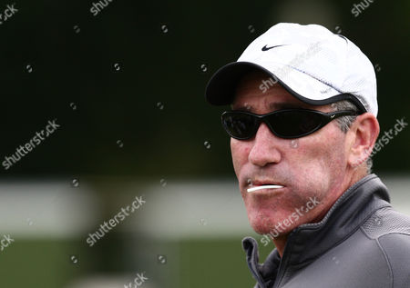 Brad Gilbert, coach of Andy Murray, turns up at Roehampton to watch Lee Childs in action sucking a lollipop