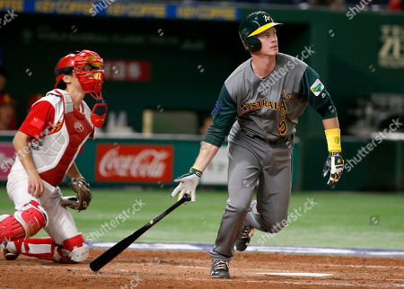 Stock Image of James Beresford, Li Nin Australia's James Beresford watches the flight of his grand slam off China's pitcher Lu Chao in the eighth inning of their first round game of the World Baseball Classic at Tokyo Dome in Tokyo, . At left is China's catcher Li Nin