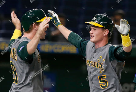 James Beresford, David Kandilas Australia's James Beresford, right, celebrates with teammate David Kandilas after hitting a grand slam off China's pitcher Lu Chao in the eighth inning of their first round game of the World Baseball Classic at Tokyo Dome in Tokyo